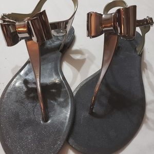 CUTENESS Pewter/metallic color.  Sparkles in sole.